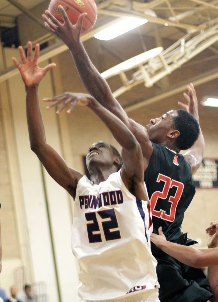 There was just no denying Rondae Jefferson, here leaping over Penn Wood's Amadou Kaba for a rebound, and his Chester teammates in a come-from-behind, 77-58 win over Penn Wood Thursday. (Times Staff / ROBERT J. GURECKI)