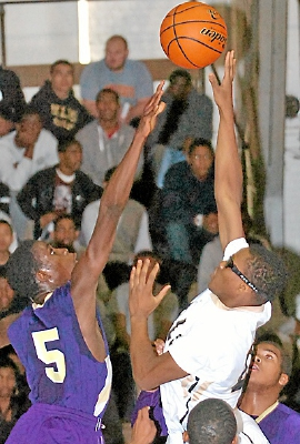 Glen Mills' Ricky Readus goes up for a shot against Upper Darby's Kuity Slanger. TIMES STAFF/JULIA WILKINSON