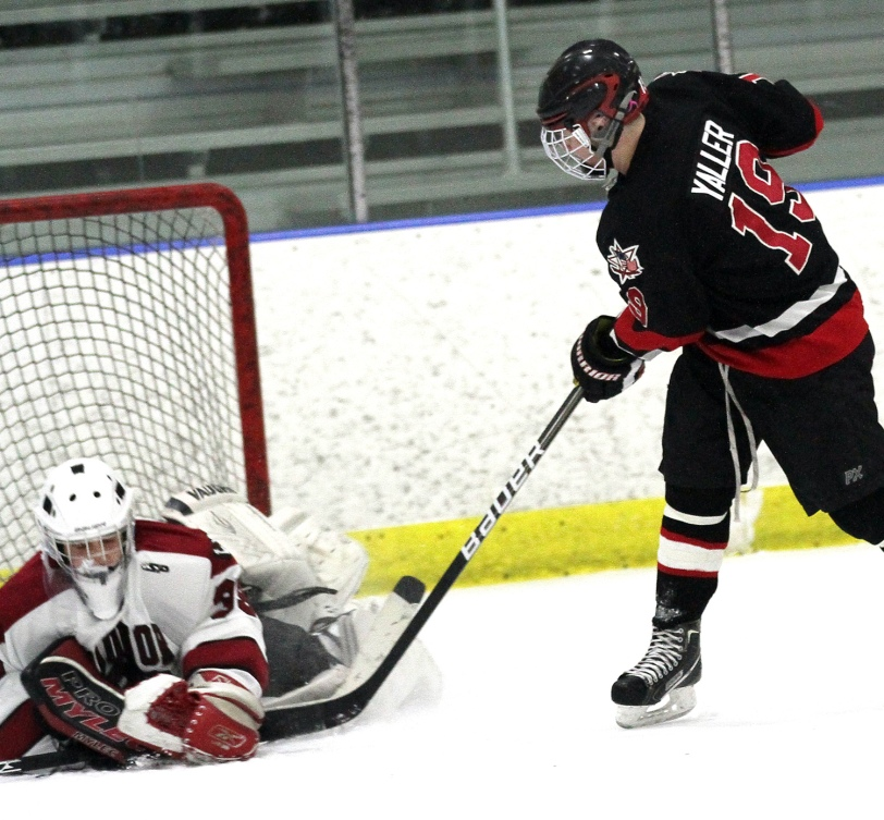 Radnor goalie Thomas Hemcher, here thwarting the hat trick bid of Archbishop Carroll's Shane Yaller, has stepped into the starter's job after the season-ending injury of Grayson Mameniskis. (Times Staff / ROBERT J. GURECKI)