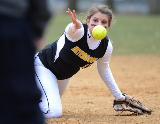 Interboro's Stacie Hallinan makes a backhanded flip toward first base in the Bucs' 10-0 win over Ridley. TIMES STAFF/ERIC HARTLINE