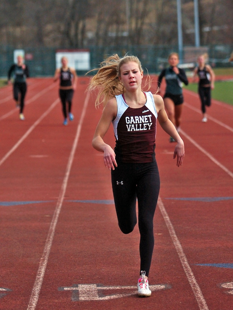 Garnet Valley's Katie Keyser leads the pack in the 400 during a meet with Ridley and Radnor. (Times Staff/JULIA WILKINSON)