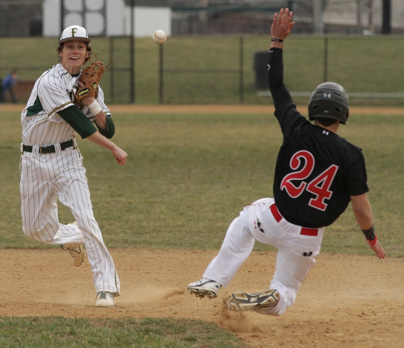 Bonner-Prendergast second baseman Richie Tecco, left, tries to complete the double play under duress from Archbishop Carroll's Joe DiWilliams in the fifth innings of the Firars' 10-1 win Thursday. (Times Staff/ROBERT J. GURECKI)