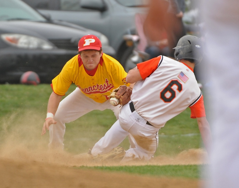 Penncrest third baseman Zach Macerato, left, can't get the tag down on Marple Newtown's Austin DiFabio Thursday during the Lions 5-4 win. (Times Staff / ERIC HARTLINE)