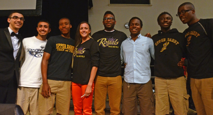 Members of the Upper Darby track team pose with track stars Fawn Dorr, third from left, and Manteo Mitchell, third from right, at during a school assembly Wednesday. (Times Staff / JULIA WILKINSON)