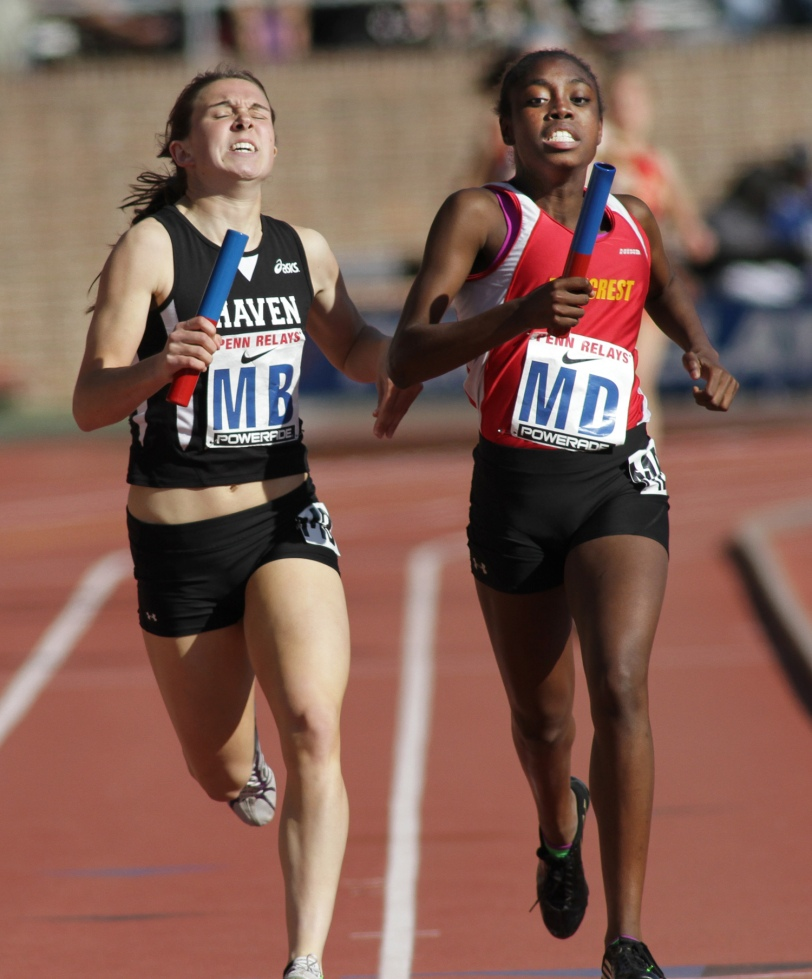 Penncrest sprinter Alicia Collier, right, gets the best of Strath Haven's Kristen Miller in the Penn Relays 4 x 100 relay Thursday. (Times Staff/ROBERT J. GURECKI)