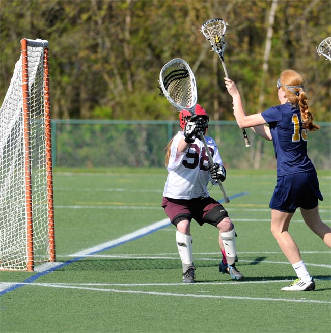 Agnes Irwin School's Lila Barker, right, shoots on net in the Owls' 12-10 win over Abington at the Katie Samson Lacrosse Festival. PHOTO COURTESY OF PHILLYLACROSSE.COM