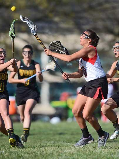 Archbishop Carroll's Natalie Schmitt, right, seen here as a junior, is in a three-way tie for the county lead in points.  TIMES FILE ART