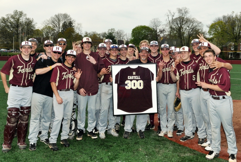 Members of the Haverford School baseball team present coach Bob Castell with a plaque commemorating his 300th win at the school Wednesday after a 7-1 defeat of Upper Darby (Courtesy photo)