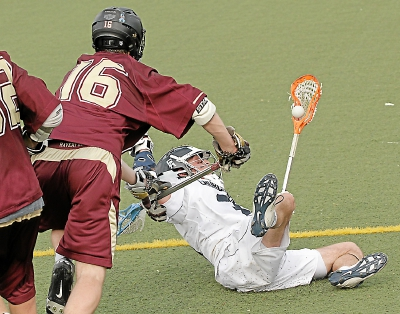 The Haverford School's Brendan Burke lowers the boom on Episcopal Academy's Ian Strain. The Fords knocked off the Churchmen, 11-6.  TIMES STAFF/ROBERT J. GURECKI
