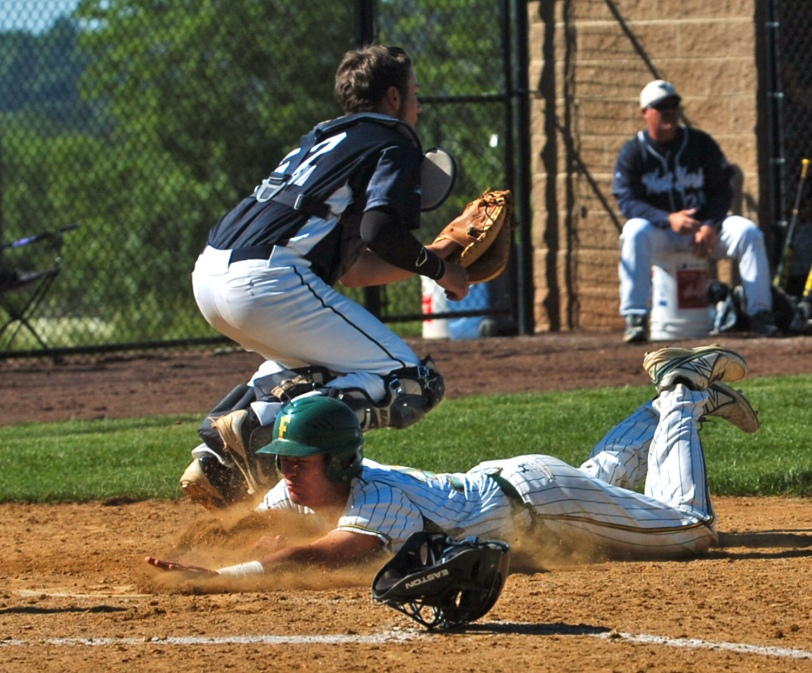 Bonner-Prendergast's Tom Crumlish slides into home ahead of West York's Cole Bixler in their PIAA Class AAA first-round game Tuesday. (Times Staff / JULIA WILKINSON)