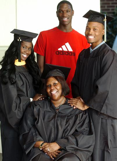 Tyrell Sturdivant (middle back) is hoping to join his family as college graduates...without paying for school. TIMES STAFF/JULIA WILKINSON