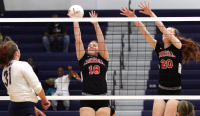Meghan Czapka, left, and Cardinal O'Hara cruised past Archbishop Carroll, 3-1, in Catholic League volleyball action. TIMES STAFF/ROBERT J. GURECKI