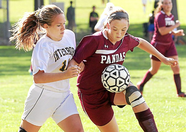 Interboro's Sabrina Loomis and Bonner-Prendergast's Molly Sullivan jostle for the ball in the Bucs' 4-0 win. TIMES STAFF/ROBERT J. GURECKI