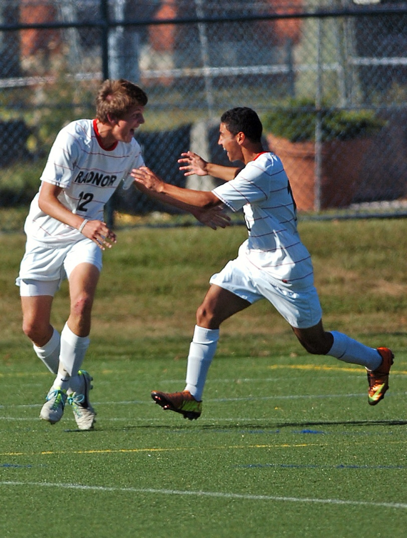 Radnor's Jack Norton, left, and Gerardo Montiel celebrate the game-winning goal in a 1-0 triumph over Upper Darby, Thursday.  TIMES STAFF/JULIA WILKINSON