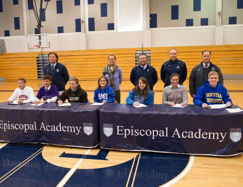 Seven Episcopal Academy student-athletes signed with Division I schools on Nov. 13. Seated (left to right): Raphael Furey (Boston University), Rich Pallazzese (Holy Cross), Matt Ernst (Lehigh), Kelly McGowan (SMU), Eliza Dorlmann (Villanova), Bernadette Tankle (Colgate), and Adam Seibert (Hofstra). Standing (l to r): EA boys lacrosse coach Andy Hayes, crew coach Molly Konopka, tennis coach Whitaker Powell, swim coach Brian Kline, and baseball coach Mike Hickey. PHOTO COURTESY OF EPISCOPAL ACADEMY