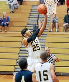 Interboro's Christian Irons goes to the basket for two of his 22 points Monday in the Bucs' win over Sun Valley. (Times Staff/JULIA WILKINSON)