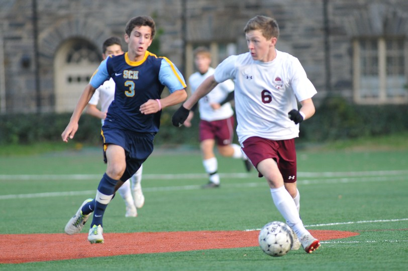 Haverford School forward Connor Gregory, here escaping Springside Chestnut Hill's Evan Wilson, was a big part of the Fords ability to defend the Inter-Ac title. (Special to the Times/PETE BANNAN)
