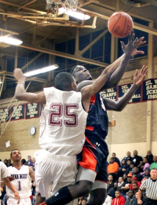 The defense of Penn Wood's Naeem East, left, against the likes of Chester's Tyrell Sturdivant Thursday was a big difference in the Patriots 65-56 win over the Clippers Thursday. (Times Staff/ROBERT J. GURECKI)