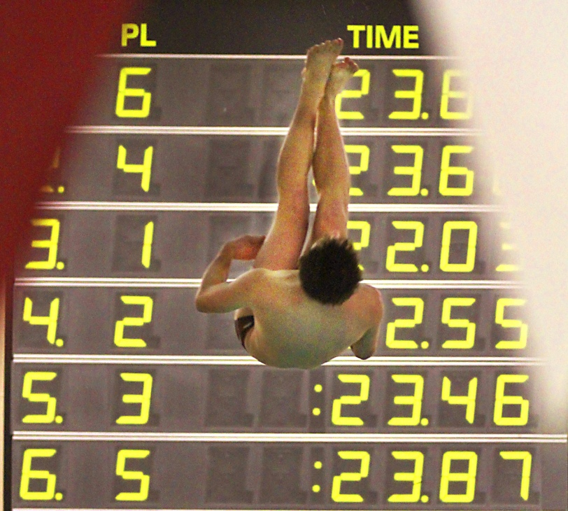Radnor diver Theo Martin attempts dive in a meet with Conestoga Monday. (Times Staff/ROBERT J. GURECKI)
