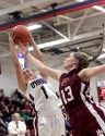 Cardinal O'Hara's Hannah Nihill, left, grabs a rebound over Bonner-Prendergast's Sarah Monaghan in Tuesday's Catholic League collision, which the Lions won, 57-56. (Times Staff/ROBERT J. GURECKI)