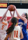 Penncrest's Katie Russo, left, and Springfield's Michelle Ronayne grab for a rebound in Saturday's 46-31 win for the Cougars. (Times Staff / JULIA WILKINSON)