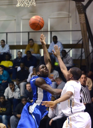 Academy Park's Travis Smith get to the basket with Glen Mill's Tyreek Brickus defending Tuesday. (Times Staff / JULIA WILKINSON)