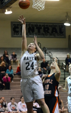 Strath Haven's Bridget Scott lays it up and in for two points as Marple Newtown's Rylee Power looks on Thursday. (Times Staff / JULIA WILKINSON)