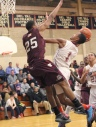 Lower Merion's Justin McFadden, left, played a big role in bottling up Penn Wood's Malik Jackson in the Aces' 58-43 win Tuesday. (Times staff/ROBERT J. GURECKI)
