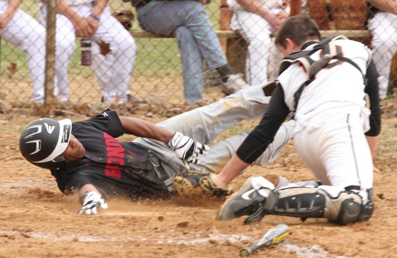Marple Newtown catch Jack Shelvin, right, tags out Radnor's Connor Wilson in the first inning Tuesday. (Times Staff/ROBERT J. GURECKI)