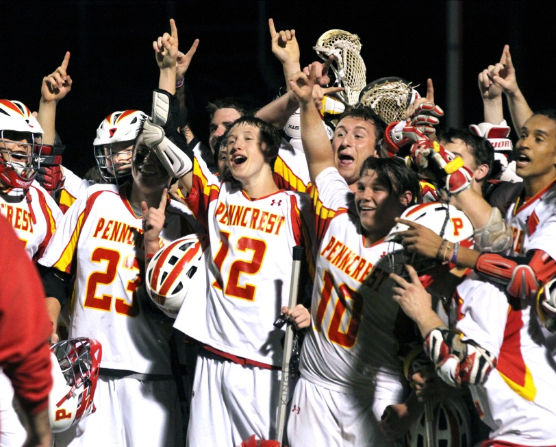 The Penncrest boys lacrosse team celebrate Thursday's 7-5 win over Radnor that clinched at least a share of the Central League title. (Times Staff/ROBERT J. GURECKI)