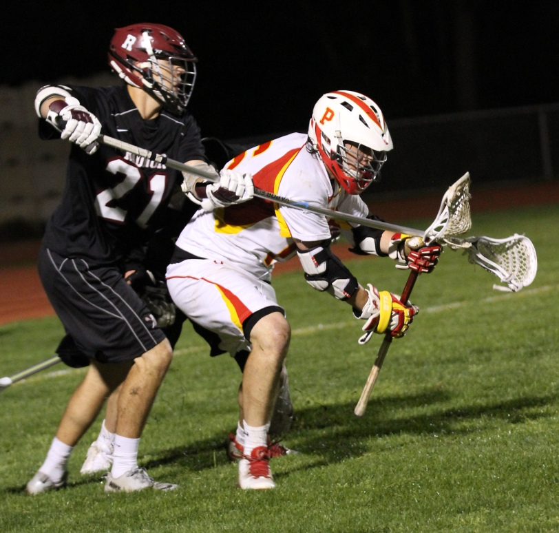 A pair of All-Central picks, Radnor defenseman Mike Farnish, left, and Penncrest attacker Will Manganiello go at it May 1 in a 7-5 win for the Lions. (Times Staff/ROBERT J. GURECKI)