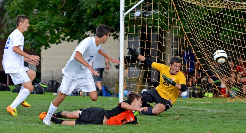 Nick Jannelli, center, here ringing a shot off the post past Marple Newtown goalkeeper Josh Gotlib Sept. 16, and his Springfield team is in the thick of a crowded Central League pack.  (Times staff / TOM KELLY IV)