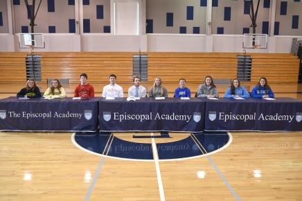 Ten Episcopal Academy student-athletes signed with Division I schools on Nov. 12. Seated (left to right): Lily Crager (University of Michigan), Jane Crager (University of Michigan), Curtis Zappala (University of Maryland), Chris Friedman (University of Hartford), Colin Reder, (University of North Carolina), Genevieve McCormick (Army), Josh Owsiany (Duke University), Maria Kilcullen (Loyola-Md.), Ali Rushton (University of North Carolina), and Christy Palazzese, (Duke University).