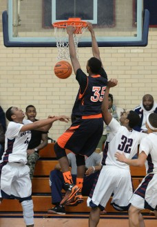 Chester's Jordan Camper, here dunking over a pair of Penn Wood defenders Jan. 22, is among the players the Clippers need to get more from in the District One playoffs and beyond. (Times Staff/ROBERT J. GURECKI)