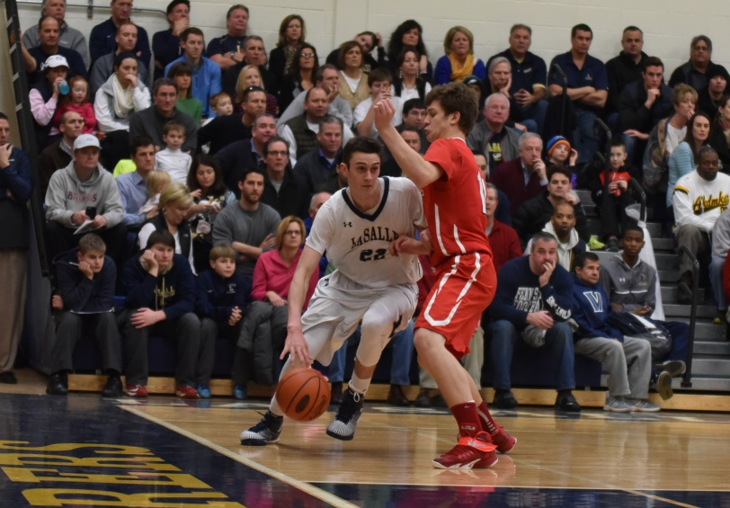 Archbishop Carroll's Ryan Daly, here guarding La Salle's David Krmpotich Jan. 25, has helped keep the Patriots consistently successful this season. (Special to the Times)