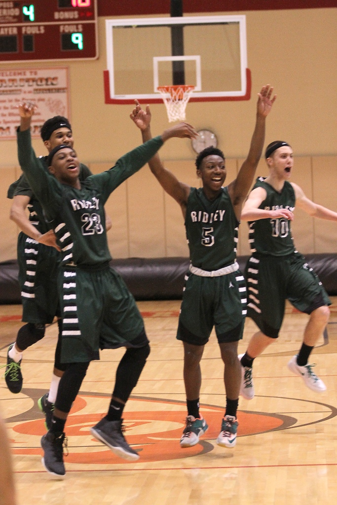 The celebration for Ridley's Ameer Staggs, left, Brett Foster, center, and Ryan Bollinger, was on Monday night after winning the Central League championship at the expense of Conestoga. But it's right back to business Friday against Rustin. (Times Staff/ROBERT J. GURECKI)