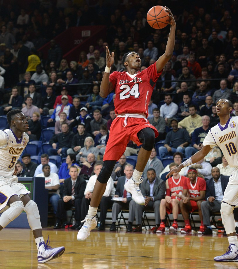 Archbishop Carroll's Derrick Jones, seen at the Palestra in the Catholic League semis against Roman Catholic, is no stranger to an up-tempo game like what he'll see against Octorara Friday. (Times Staff/TOM KELLY IV)