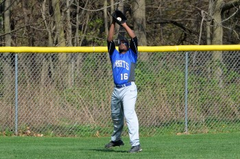 Academy Park's Tamir Ware, here catching a fly ball against Interboro Tuesday, is near the county lead with five doubles this season. (Times Staff/TOM KELLY IV)
