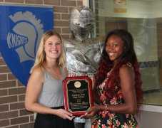Academy Park captains Pam Neill and Daa'iyah Allen poses with the 2015 PASLA Sportsmanship award.